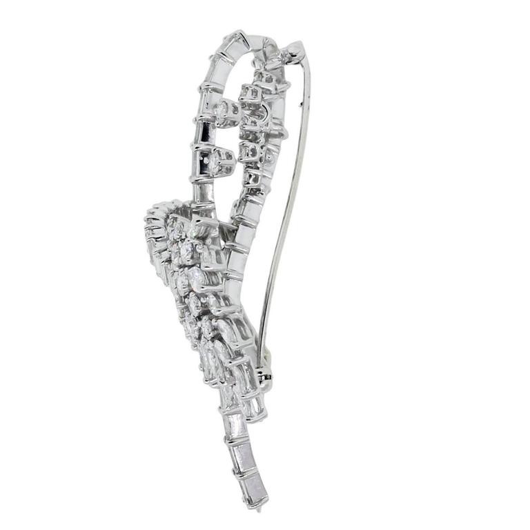 Style: Platinum 6ctw Diamond Vintage Brooch Pin Material: Platinum Diamond Details: Approximately 6ctw of of Baguette, Round Brilliant and Marquise Diamonds. Diamonds are F/G in color and VS in clarity. Clasp: Pin stem & secure closure Pin