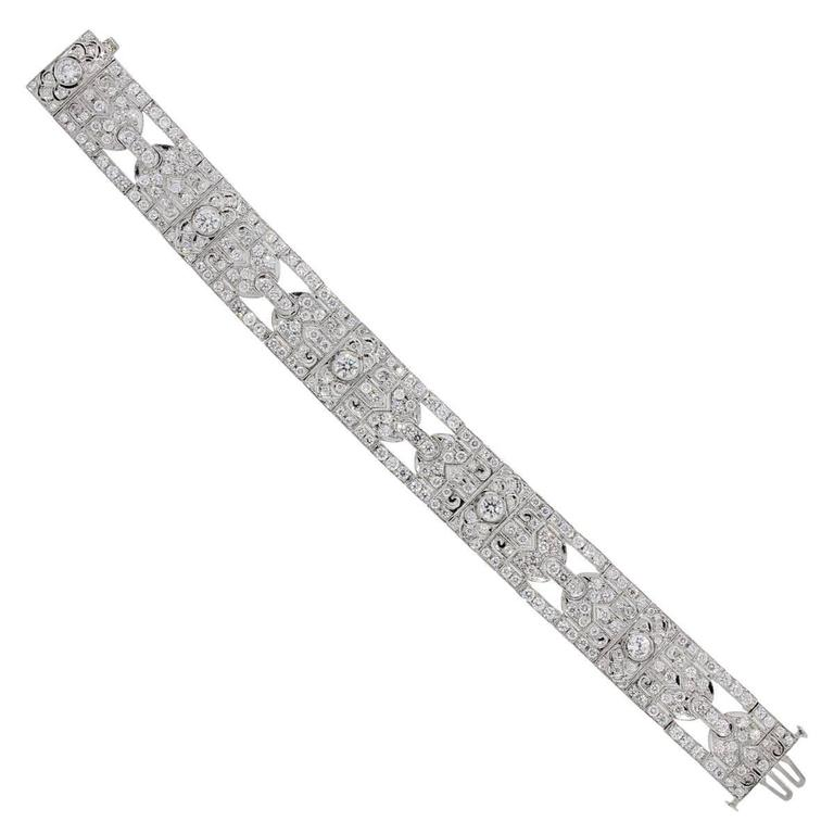 Style: Platinum 7.25ctw Diamond Deco Style Bracelet Material: Platinum Diamond Details: Approximately 7.25ctw of Round Brilliant Diamonds. Diamonds are G/H in color and VS in clarity. Total Weight: 54.2g (34.9dwt) Measurements: Fits a 7