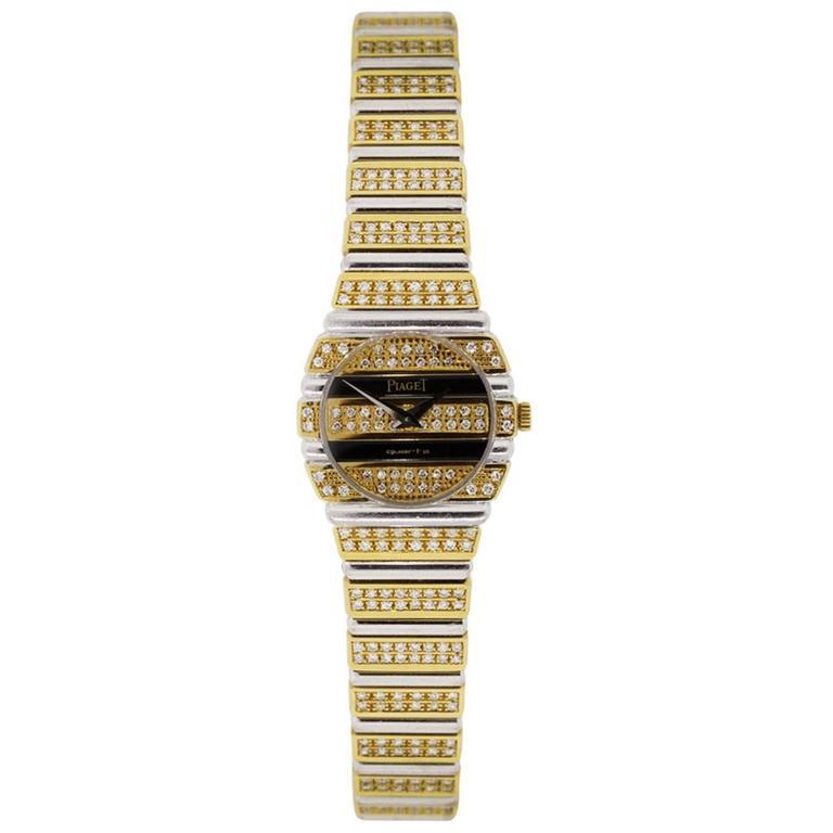 Brand: Piaget MPN: 861C Model: Polo Case Material: 18k yellow gold Case Diameter: 23.5mm Bezel: 18k white and yellow gold with diamonds (factory) Dial: 18k yellow gold with diamonds and black Onyx and silver hands. (factory) Bracelet: 18k
