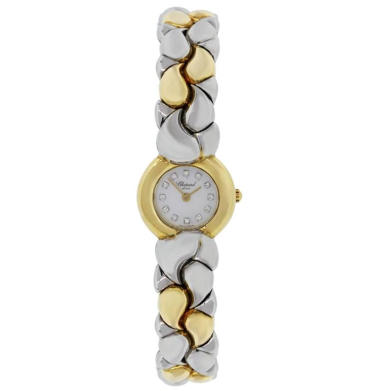 Brand: Chopard Model: Casmir MPN: 89151 Case Material: 18k yellow gold Case Diameter: 24mm Bezel: Smooth 18k yellow gold bezel Dial: Mother of pearl diamond dial with gold hands Bracelet: 18k yellow gold and stainless steel Crystal: Sapphire