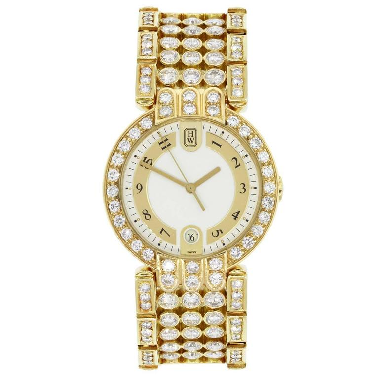 Brand: Harry Winston MPN: MQ 34 GL Model: Premier Case Material: 18k Yellow Gold Case Diameter: 34mm Crystal: Sapphire Bezel: Diamond bezel (aftermarket) Dial: Two tone matte cream and gold color dial with date window at 6 o'clock