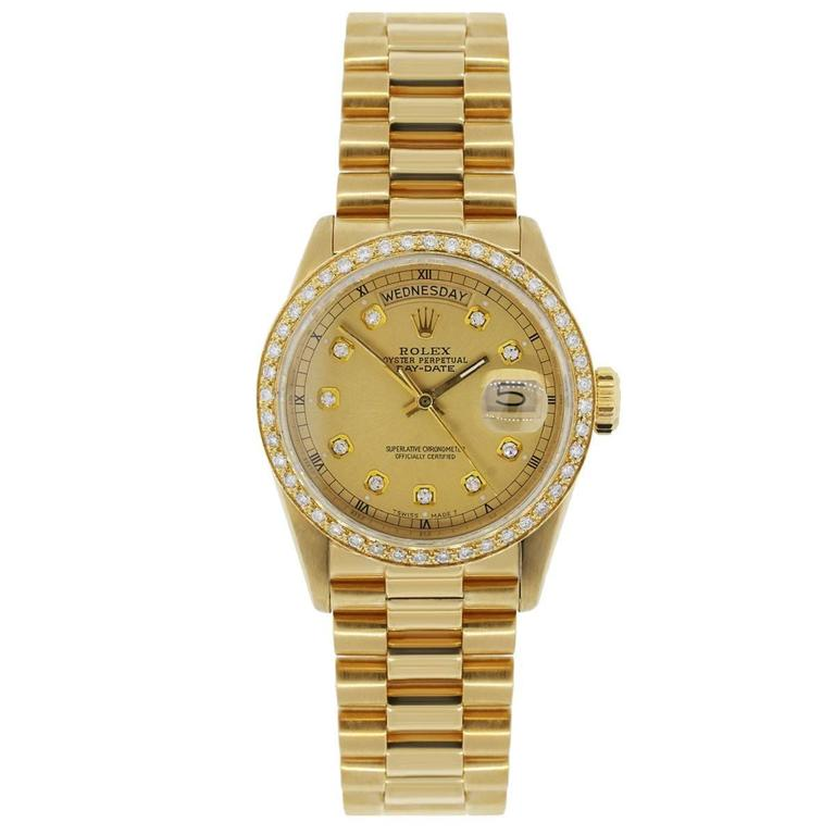 Brand: Rolex MPN: 18038 Model: Day-Date Case Material: 18k Yellow Gold Case Diameter: 36mm Crystal: Sapphire crystal (scratch resistant) Bezel: Diamond bezel (aftermarket) Dial: Champagne diamond day date dial (aftermarket) Bracelet: Presidential