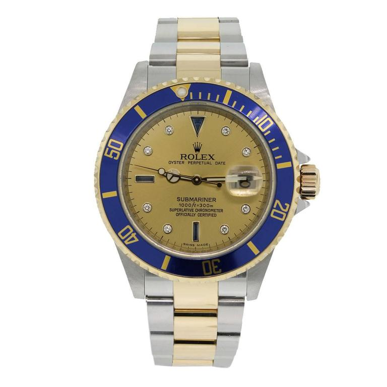 "Brand: Rolex Style: Submariner MPN: 16613 Serial: ""A"" Serial Case Material: Stainless steel Case Diameter: 40mm Bezel: Unidirectional 18k yellow gold bezel with blue insert Dial: Champagne diamond and blue sapphire serti dial"