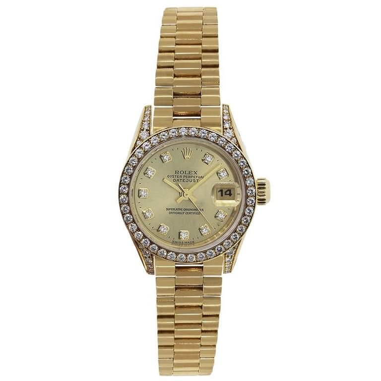 Brand: Rolex MPN: Datejust Model: 69158 Case Material: 18k Yellow Gold Case Diameter: 26mm Crystal: Original Rolex Sapphire Crystal Bezel: 18k yellow gold diamond bezel (factory) Diamonds are G in color and VS in clarity. Diamonds extend onto case