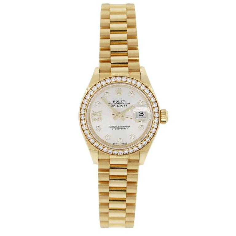 Brand: Rolex MPN: 27913RB  Model: Datejust Case Material: 18k yellow gold Case Diameter: 28mm Crystal: Sapphire crystal Bezel: Diamond bezel (factory) Dial: Silver diamond dial with date window at 3 o'clock position (factory) Bracelet: 18k yellow