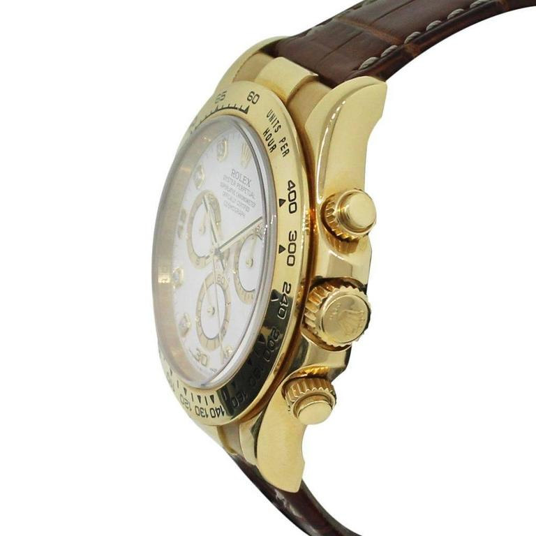 Rolex Daytona Yellow Gold White Dial Wristwatch In Excellent Condition For Sale In Boca Raton, FL