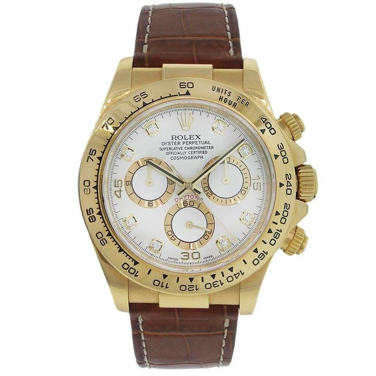 Brand: Rolex MPN: 116518 Model: Daytona Case Material: 18k Yellow Gold Case Diameter: 40mm Crystal: Sapphire Bezel: 18k yellow gold fixed engraved Tachymetric scale Dial: White dial with diamond hour markers and 3 white and gold Chronograph