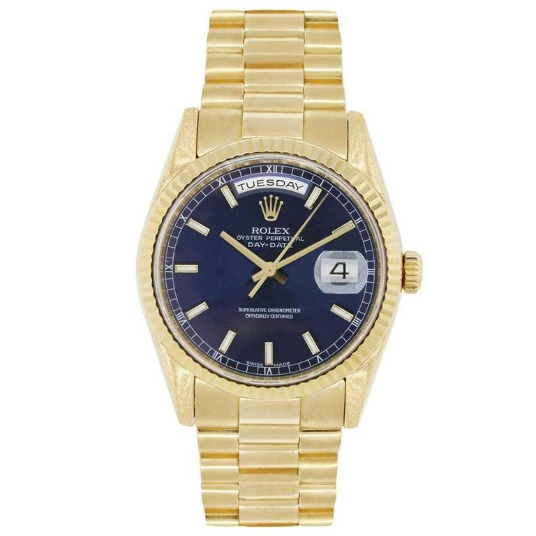 Brand: Rolex MPN: 118238 Model: Presidential Day Date Case Material: 18k yellow gold Case Diameter: 36mm Crystal: Scratch resistant sapphire Bezel: 18k yellow gold fixed fluted bezel (factory) Dial: Blue stick dial (factory) Bracelet: 18k yellow