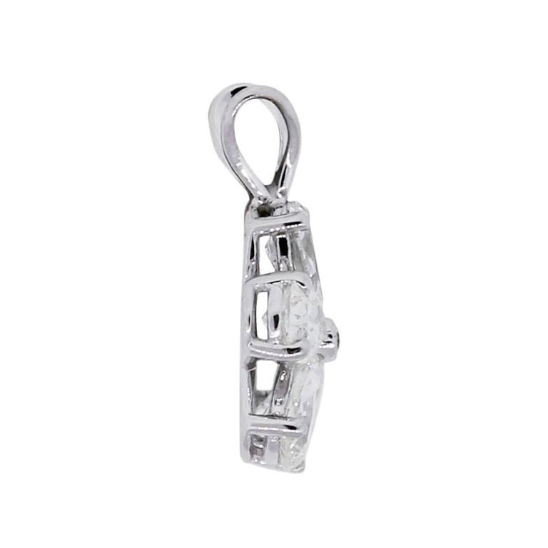 Material: 14k white gold Diamond Details: Approximately 0.99ctw of pear shape and round brilliant diamonds. Diamonds are G/H in color and SI in clarity Pendant Dimensions: 0.64″ x 0.20″ x 0.46″ Total Weight: 1g (0.6dwt) Additional Details: