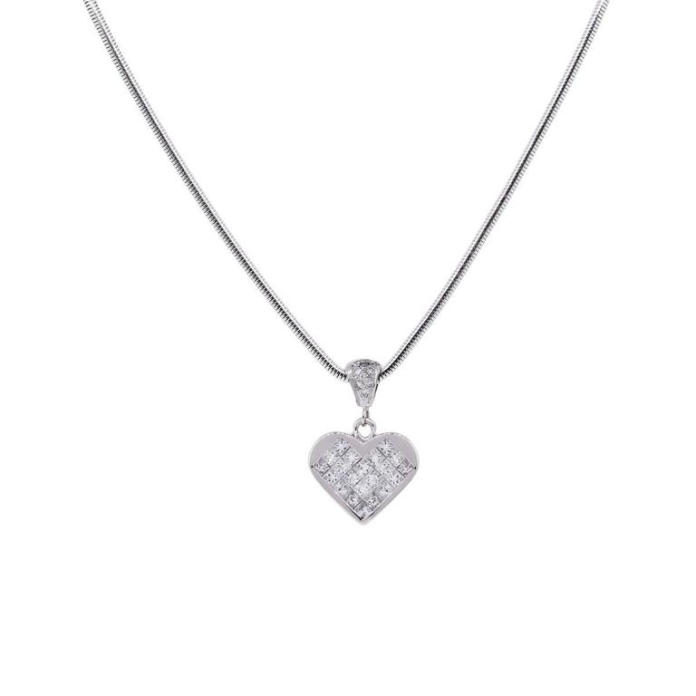 Material: 18k white gold Diamond Details: 1.70ctw of invisible set princess cut diamonds and round brilliant diamonds. Diamonds are G in color and VS in clarity. Necklace Measurements: 14k white gold snake chain is 18″ in length Pendant
