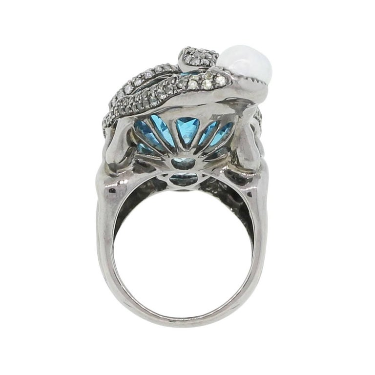 Material: Black rhodium 18k white gold Diamond Details: Approximately 3ctw of round brilliant diamonds. Diamonds are G/H in color and SI in clarity Gemstone Details: Oval shape aquamarine stone measuring approximately 1.50″ x 0.75″. Round shape