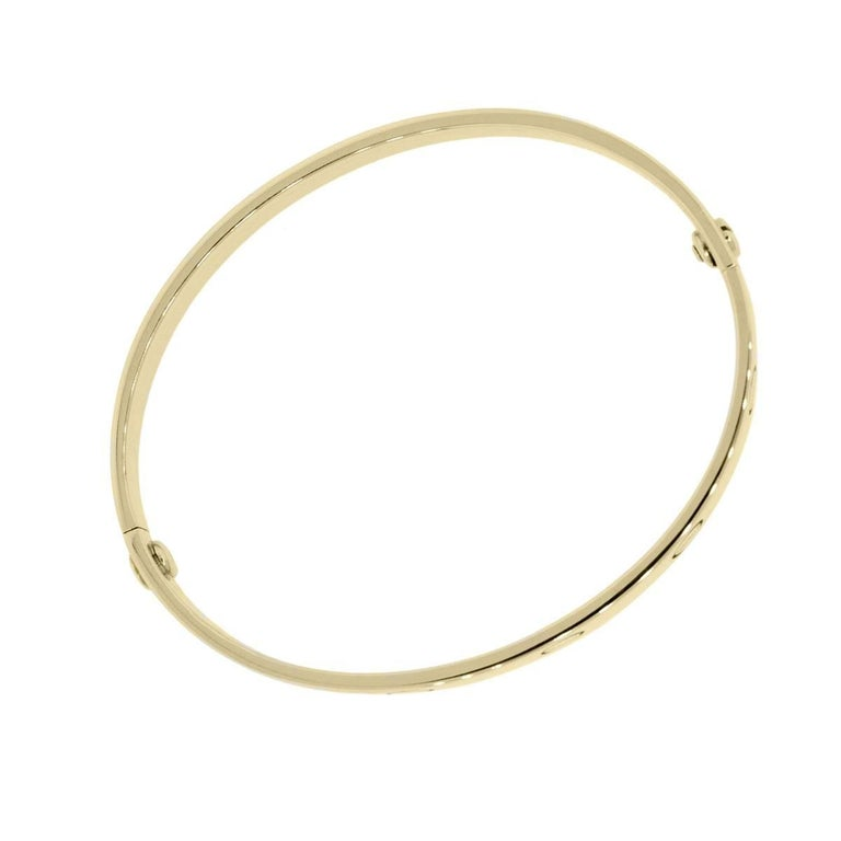 Brand: Cartier Style: Love Bangle Metal: 18k Yellow Gold Bracelet Size: Cartier size 17 (will fit a 6.25″ wrist) Total Weight: 27.2g (17.5dwt) Closure: (2) Screw Closure Additional Details: Comes with Raymond Lee Jewelers Presentation Box and