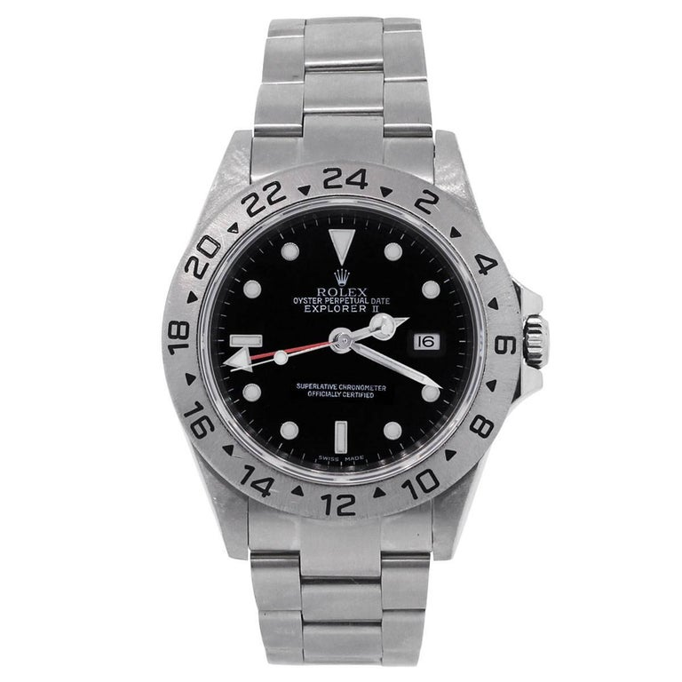 Brand: Rolex Style: Explorer II 16570 Serial #: F Case Material: Stainless Steel Case Diameter: 40mm Bezel: 24 Hour Time Display Dial: Black Dial with silver hands and luminescent hour markers. Date is displayed at 3 o' clock. Bracelet: Stainless