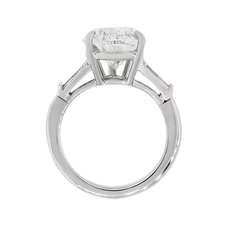 Material: Platinum Center Diamond Details: GIA certified 5.60ct pear shape diamond. Diamond is I in color and SI1 in clarity. GIA certificate #1186974489 Diamond Details: Approximately 0.30ctw of tapered baguette shape diamonds Size: 5 Total Weight:
