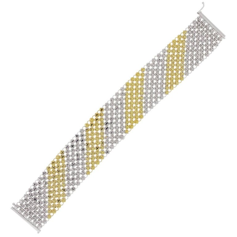 Material: 14k yellow gold and white gold Gemstone Details: Approximately 10.37ctw round brilliant diamonds. Diamonds are G/H in color and VS in clarity Fastening: Slide clasp with safety latch Measurements: Will fit a 6.75″ wrist Item Weight: