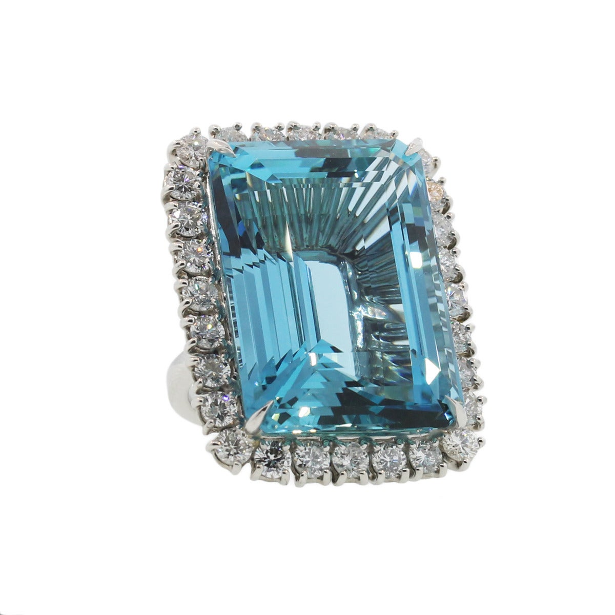 Metal: Platinum Gemstone Details: Aquamarine, 66.05ct Diamonds Details: Round Brilliant Cut Diamonds; Approximately 4.5ctw, H/I in color, VS2/SI1 in clarity Item Weight: 37.7g (24.3dwt) Ring Size: 6.5 (can be sized) Comes With: Includes a