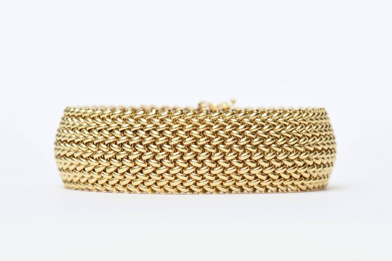 This timeless and classic stunning vintage Italian hallmarked 14K cuff bracelet has a chevron mesh gorgeous design and flexibility as a cuff bracelet. It is vintage and from the 60's. It is marked 585 !4K Italy and signed Brer. It is difficult to