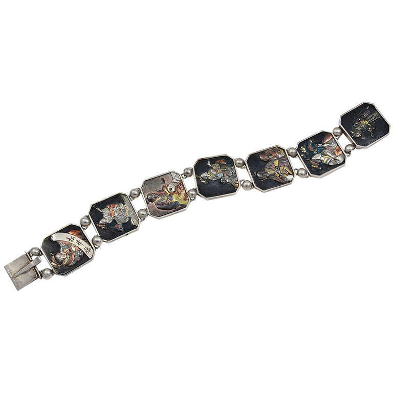 a japanese seven panel shakudo work and silver bracelet at