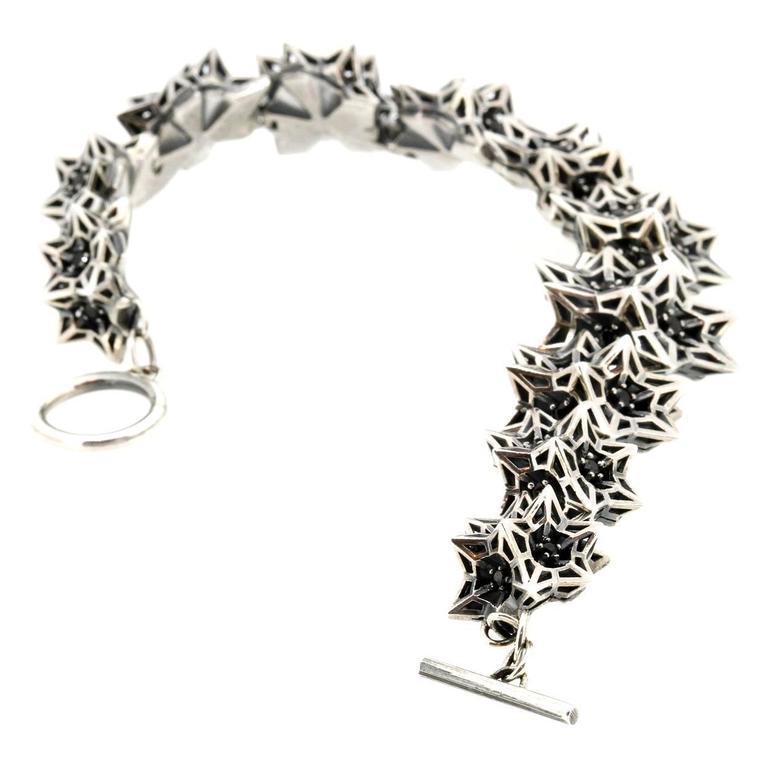 Modern Helix Frame Black Sapphires Silver Bracelet For Sale