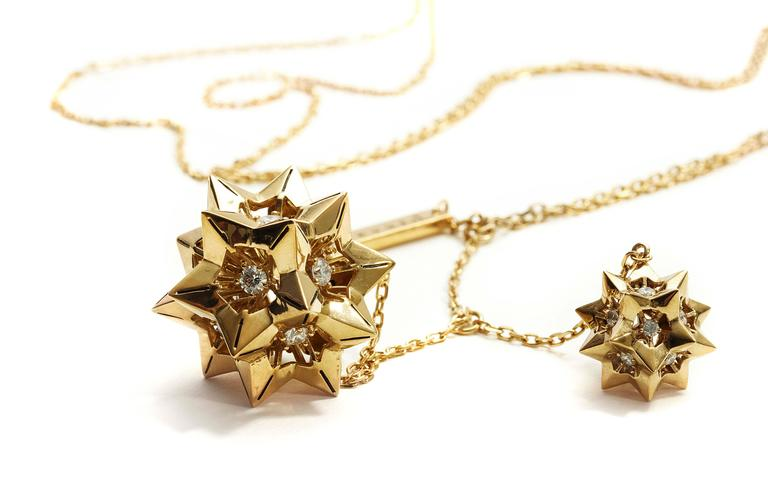 This limited edition piece is inspired by sacred geometries and patterns in nature.  These sculptural star tetrahedron earrings are from the John Brevard Verahedra series. The interlocking hedral geometries of the Verahedra series are reminiscent of