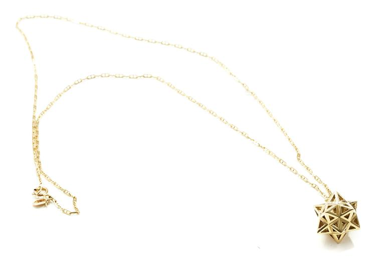 Verahedra collection necklace in 18K gold.  This piece was designed to evoke personal power.   John Brevard applies his background in architecture and multidisciplinary arts to create ethereal designs that are not only visually stunning but also