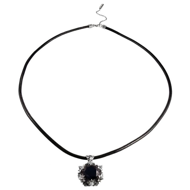This pendant represents bliss in ones life. Inspired by the universal birth and created using Thoscene, these pieces evoke a sense of stillness.  Thoscene collection pendant in sterling silver with a 14 mm Onyx. Interchangeable silver chain and
