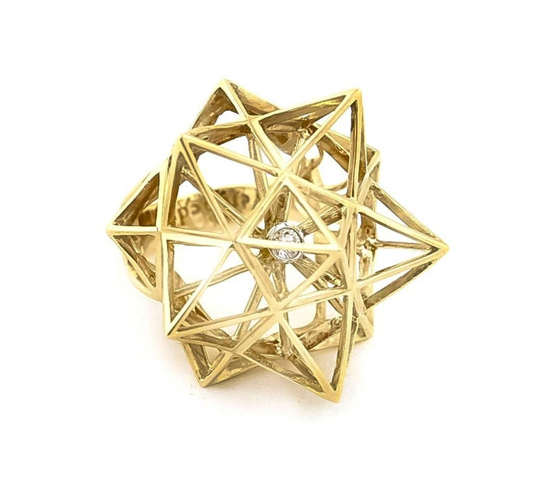 Verahedra collection statement ring in 18K yellow gold with 1 round white diamond at 3.0 mm (0.13 carats). This one of a kind piece by John Brevard can be customized in any material and size. It is inspired by sacred geometry, namely the star