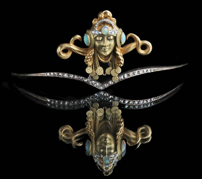 The diadem is unmarked, but undoubtedly French and possibly by Georges Fouquet or Maison Vever. The design of the female head is reminiscent of drawings and posters by the Czech artist Alphonse Mucha, who worked closely with Georges Fouquet