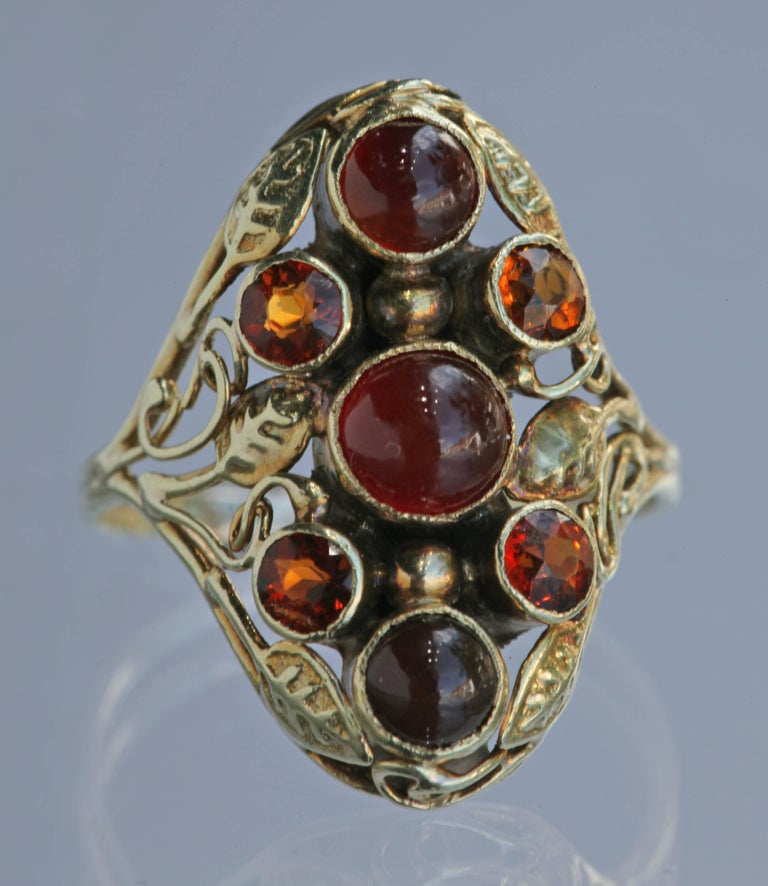 An American Arts & Crafts gold ring with carnelian & citrine. Possibly by Edward Everett Oakes.  Ring Size: [US: 6.75]  [UK:N ]