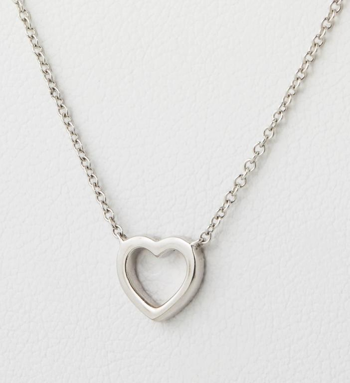 18k white gold and perfectly cut diamonds in heart suspended on chain.