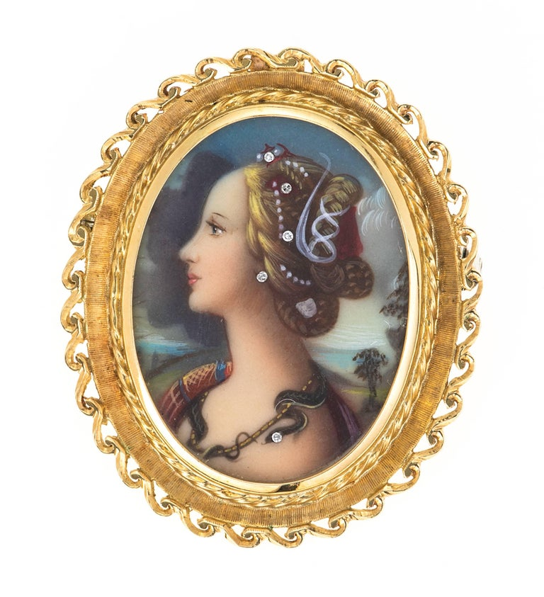 Lovely 18k gold frame around intricately painted portrait of a beautiful lady adorned with five diamonds.  Wonderful example of renaissance revival.  Hallmarked 750 on the back.   Can be worn as a necklace or a brooch .