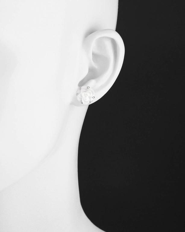"Camélia stud earrings, showcasing a carved white agate camellia flower motif, in 18k white gold, with posts and squeeze-style backs, signed Chanel. 0.5"" diameter (12.5mm)."
