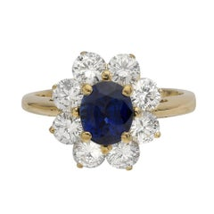 1.37 Carat Sapphire and Diamond Halo Yellow Gold Ring