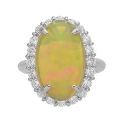 3.92 Carat Oval Opal and Diamond Halo Platinum Ring