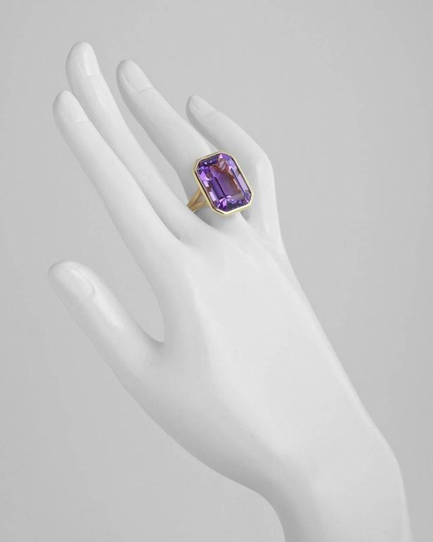 Emerald-cut amethyst cocktail ring, mounted in polished 18k yellow gold with an elegant split shank. Amethyst measuring 20 x 14mm. 11.36 grams weight. Designed by Goshwara. Size 4.5