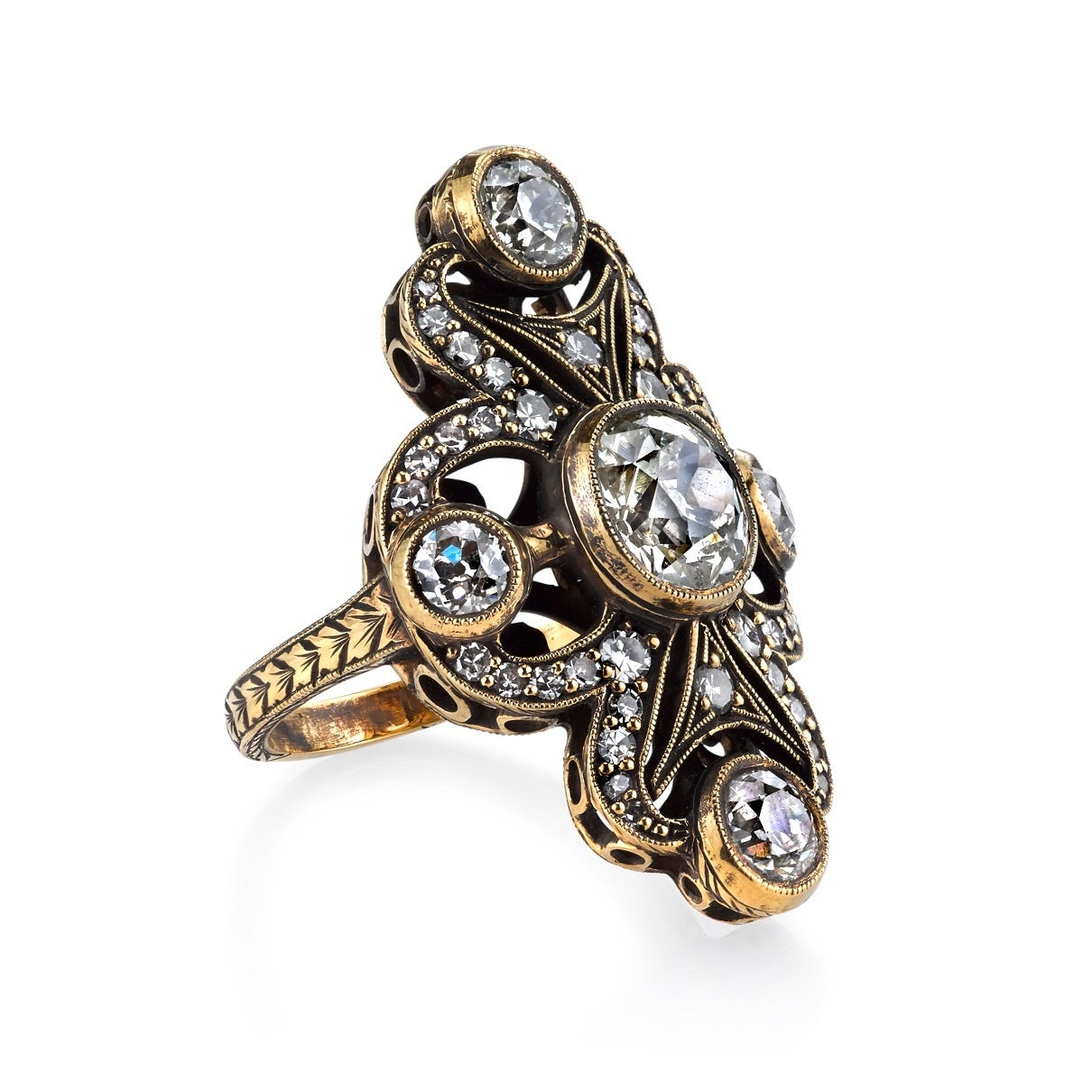 1.69ct N/I1 vintage Cushion cut diamond center stone with 1.54ctw old European cut diamond accents set in a handcrafted 18K oxidized yellow gold mounting.  Dynamic lines, intricate details and swirl motifs give this one of a kind ring its old world