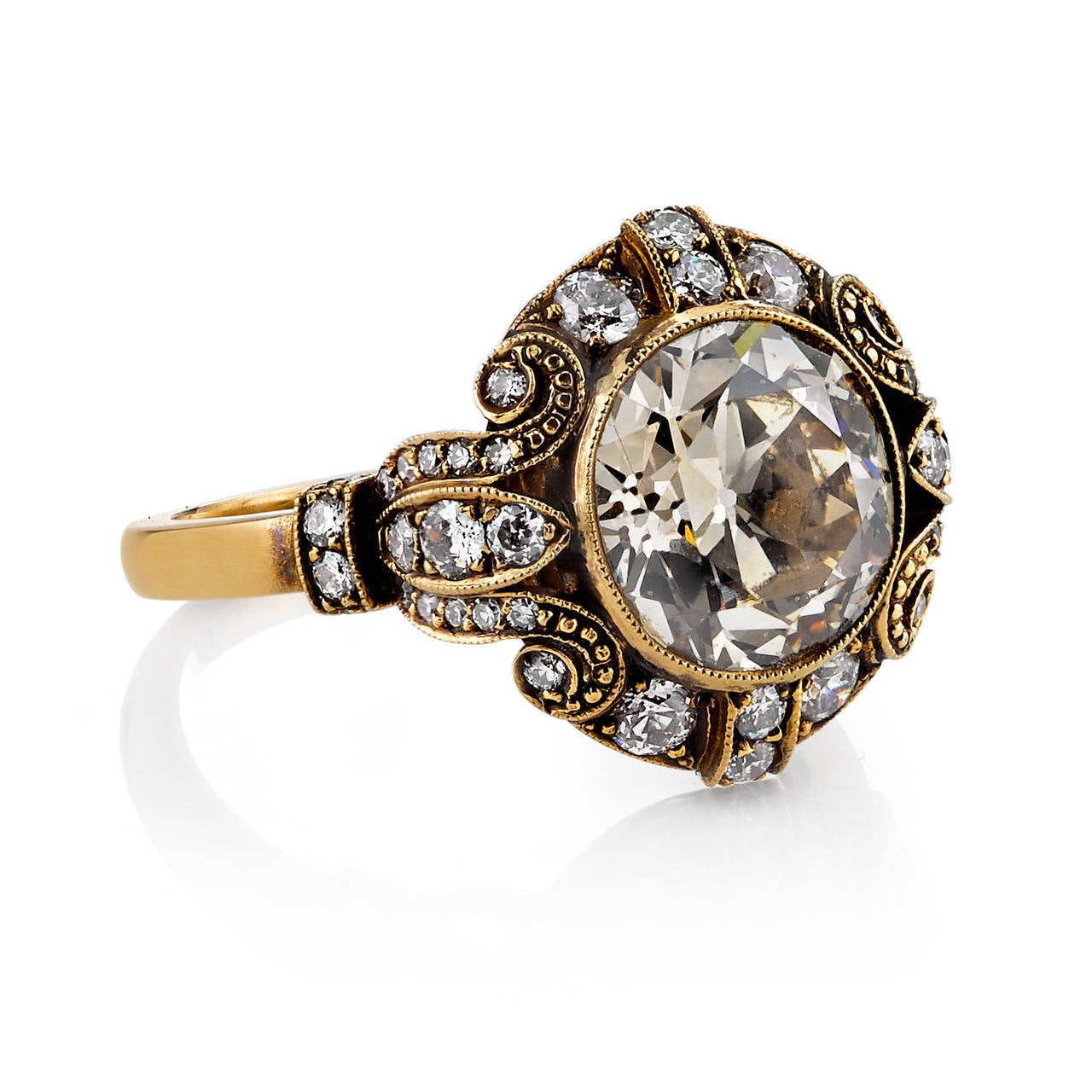 3.07ct Rose Brown/ SI old Mine cut diamond set in a handcrafted 18k oxidized yellow gold mounting. An Art Deco design featuring a bezel set diamond and beautiful scroll work.