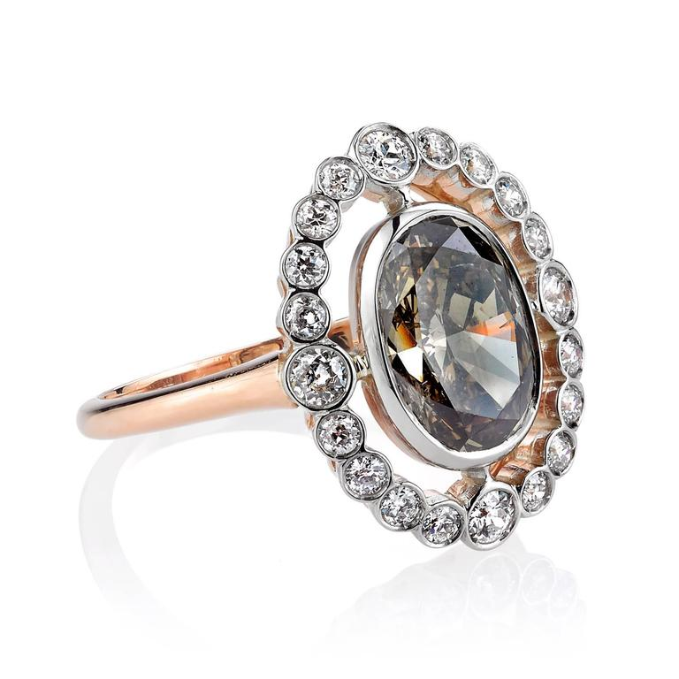 2.41ct Brown/ SI3 Oval cut diamond set in a handcrafted 18k rose gold and platinum mounting.