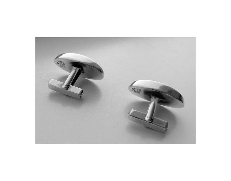 Pair of Danish Sterling Cufflinks, N.E. From, C.1950. The cufflinks of a plain oval striking concave form, `t' bar fitments. Stamped Sterling Denmark N.E. From 925 S. Measures: 1 x .5 inches. Weight: 11.92 gm.
