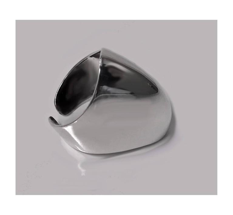 Bent Knudsen Danish Sterling mid 20th century large plain polished ovoid abstract Ring, design 56 signed Bent K. Item Weight: 6.8 gm. Ring Size: 7-8