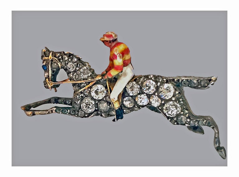 Fine 19th Century Diamond Enamel Racehorse Brooch Pin, C.1890. The horse encrusted with old european, old mine and rose cut diamonds, total diamond weight, approximately 1.00 ct.  mounted in cut down silver on gold, the eyes inset with cabochon