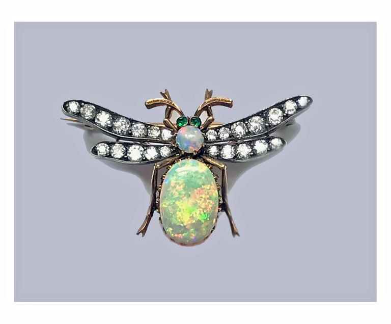 Fine 19th century Opal and Diamond Bee Brooch Pendant, English C.1890. The Brooch with removable reverse fitment convertible to pendant, abdomen and thorax set with oval and round cabochon opal, good play of colour, the wings set with twenty four