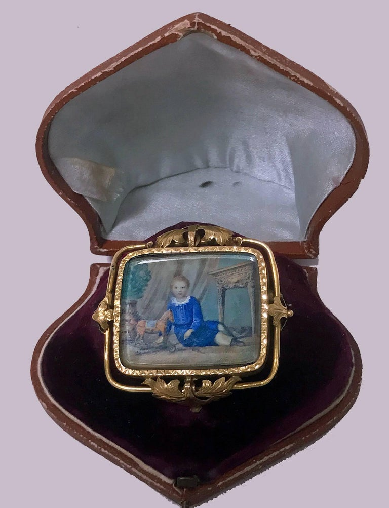 Antique Portrait Miniature original beveled crystal, Swiss, C.1800, attributed Anton Graff, depicting a boy with pull toy and orange tree, foliate gold (tests as 18K) frame (minor solder at reverse), fitted box. Anton Graff (1736-1813) was among the