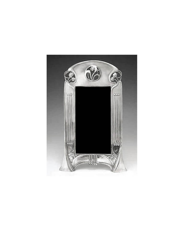 Art Nouveau silver plate Photograph Frame, WMF Germany C.1906. The Frame, secessionist and art nouveau design with open stylised berries. Illustrated WMF 1906 Catalogue, page 305 No 132. Original back and easel. Overall measurements: 11 3/4 x 6 1/4
