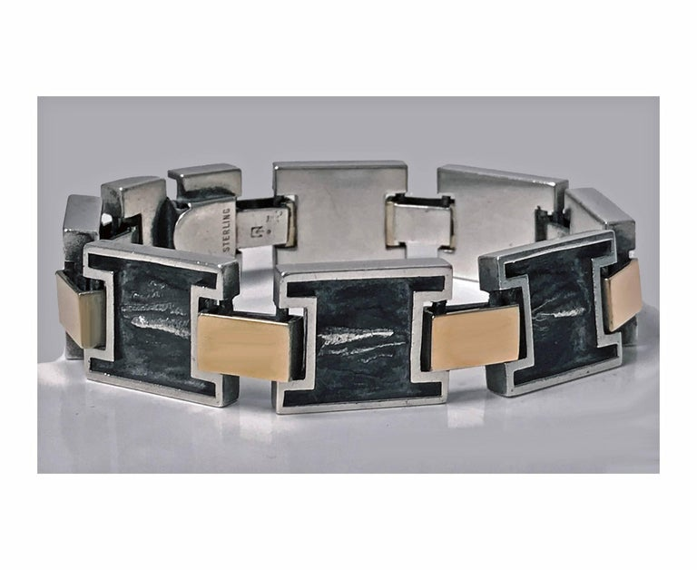1960's Modernist 18K and Sterling reversible handmade Bracelet. The Bracelet with eight incuse sterling rectangular links oxidised organic brushed finish with high polished surround mounts, 18K yellow gold rectangular links between, terminating with