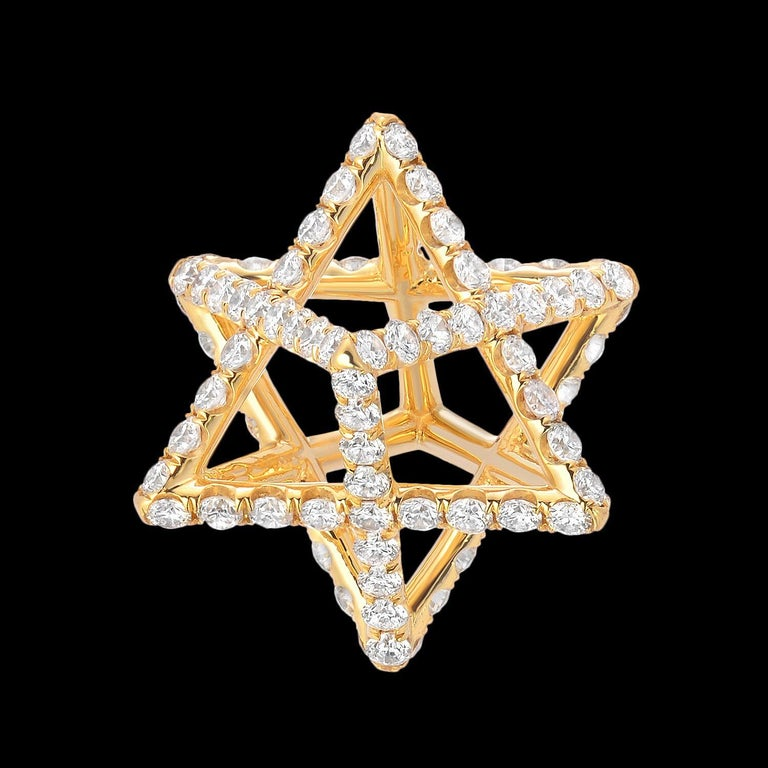 """This Merkaba 18K yellow gold pendant-necklace features a total of approximately 1.12 carats of round brilliant diamonds of F-G color and VVS2-VS1 clarity. This heirloom-quality piece suspends elegantly at the chest, measuring 0.68"""", a"""