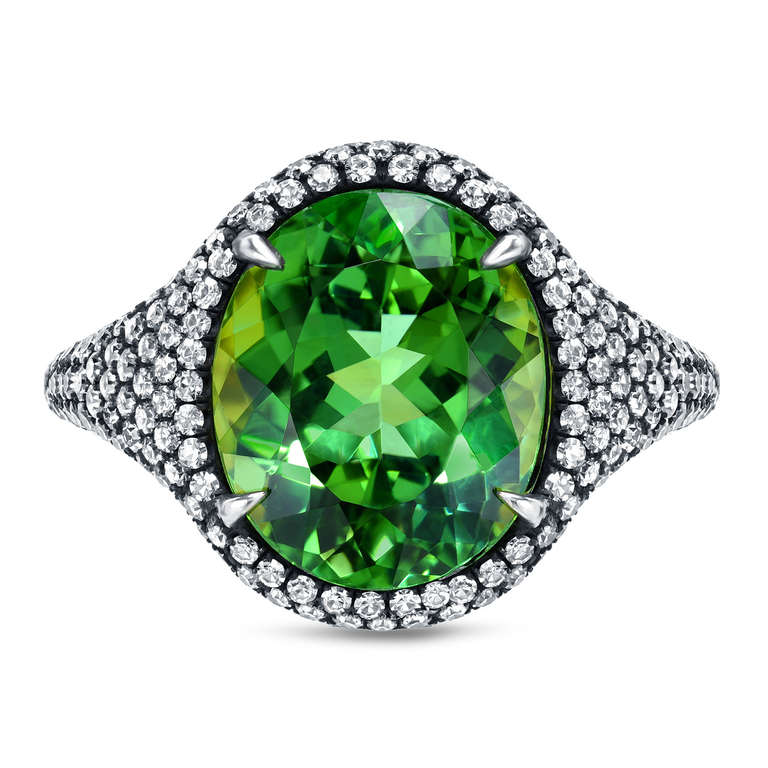 A vibrant 5.40ct Mint Green Tourmaline and 1.54ct F-G color and VS clarity, diamond ring. Crafted by hand in 18K yellow gold topped with black-finished silver. Finger size 6. Re-sizing is complimentary upon request. Signed Tamir. Hand made in the