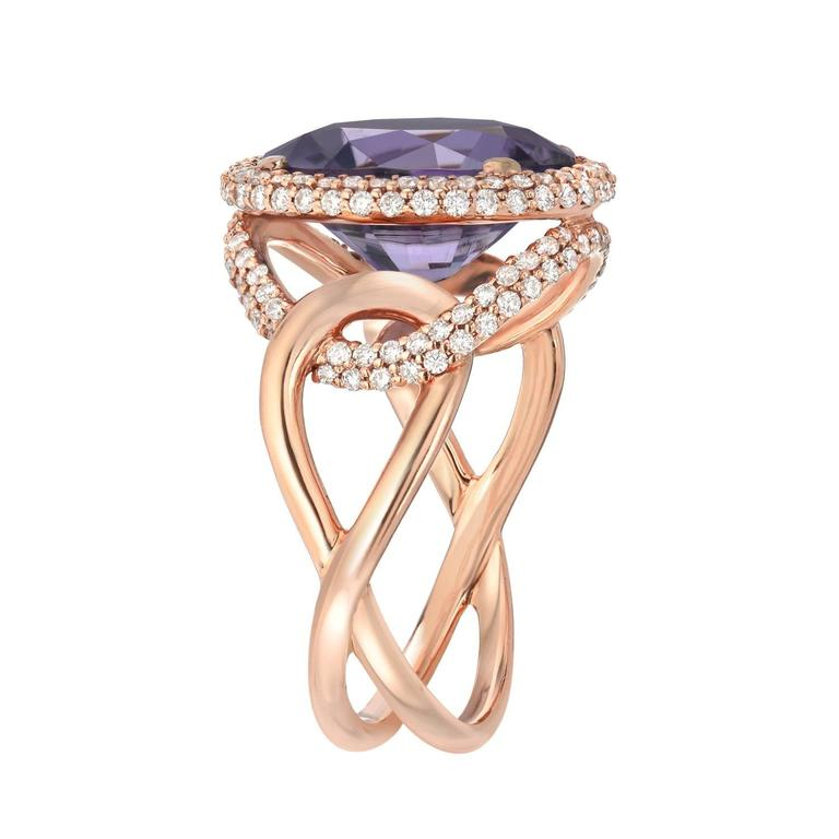 A rare and electric 5.59ct oval Lavender Tourmaline, is set in this gorgeous 18K rose gold ring, micro-set with a total of 0.86ct diamonds.  Size 6.5. Re-sizing is complimentary upon request.