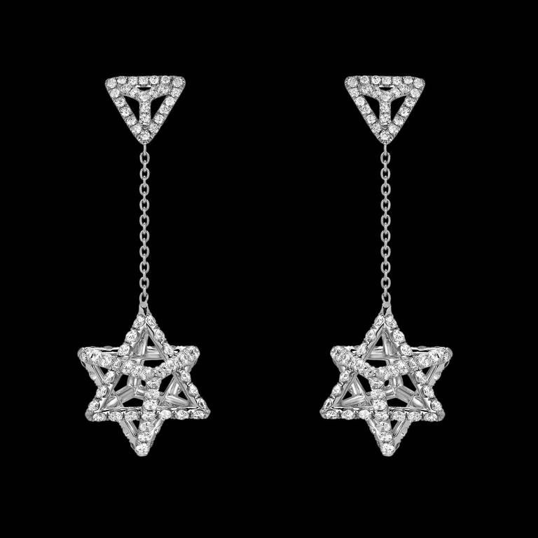 Delicate Merkaba platinum drop earrings, tethered by a triangle stud, feature a single chain suspending a Merkaba star measuring 0.57 inches. Secure screw or La Pousette ear backs mirror the triangle motif. Set with a total of approximately 2.39