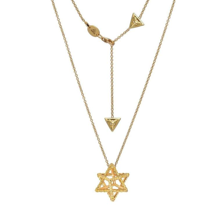 This Merkaba 18k yellow gold necklace features a total of approximately 1.28 carats of round brilliant fancy yellow diamonds. This heirloom-quality, geometric jewelry piece, suspends elegantly at the chest, measuring 0.68 inches, a three-dimensional